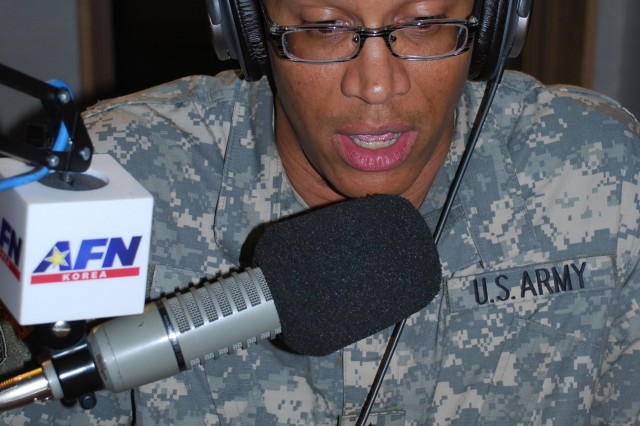 """Broadcast NCO Sgt. First Class Pete Mayes works his """"magic"""" as the morning radio disc jockey at the headquarters in Yongsan."""