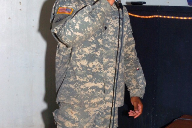 """Specialist Thomas Hairston, a battalion training clerk for 44th Expeditionary Signal Battalion, sings """"Bad Day"""" by Fuel during karaoke night at MWR 124 on Camp Victory June 3. Hairston, a Winston-Salem, N.C., native, has been singing since he was a child and said karaoke is a way for him to get away now and then"""