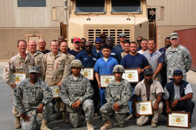Members of the 401st Army Field Support Brigade's Forward Repair Activity and contract employees with L3 Corporation pose with (far right) Col. Terence Hermans, commander, 4th Sustainment Brigade, and (front row, left-right) Master Sgt. Melvin Arnold, Noncommissioned Officer in Charge, 4th Sustainment Brigade Maintenance Management Office, and HET drivers Pfc. Xavier Vargas and Spc. Antonio Garza, 546th Transportation Company, July 24, 2008, at Camp Arifjan, Kuwait.
