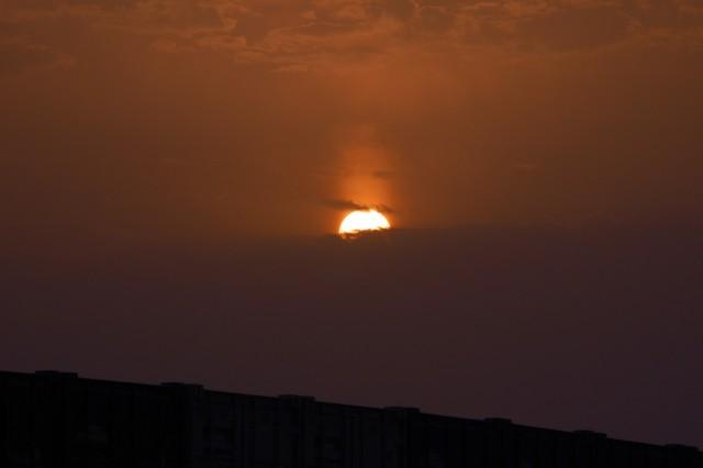 'At Bagram Airfield the Sun sets behind the Hindu Kush...'