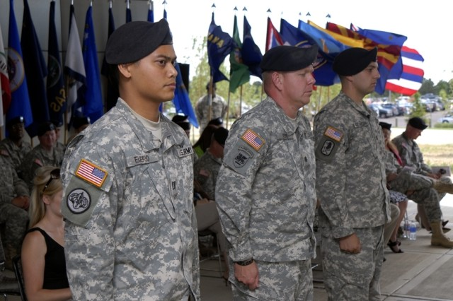 Outgoing Company Commander, Capt. Michael Euperio, Battalion Commander, Lt. Col. Patrick Kerr, and Incoming Company Commander, Capt. Jonathan Gendron, stand at attention during Headquarter and Headquarters Company, 53rd Signal Battalion's Change of Command ceremony on July 8.