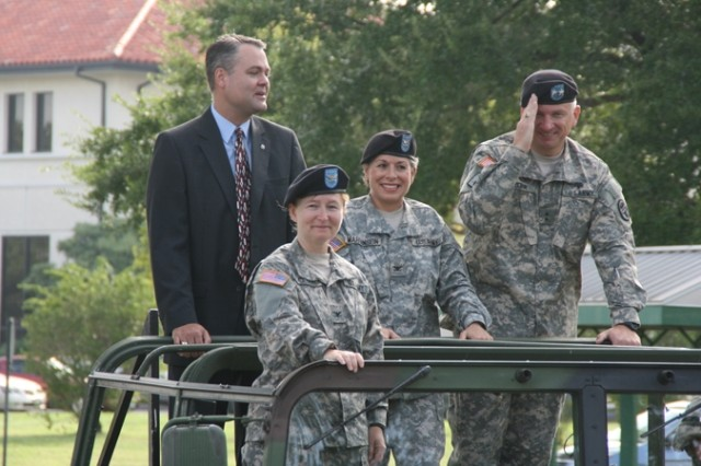 The official party that includes J. Randall Robinson (left) director, U.S. Army Installation Management Command-West Region; Col. Mary Garr (left, front), incoming commander, U.S. Army Garrison Fort Sam Houston; Col. Wendy Martinson (center) outgoing garrison commander; and Maj. Gen. Russell Czerw (far right), commanding general, Fort Sam Houston and Army Medical Department Center and School, perform a symbolic tour of the garrison before the change of command ceremony July 29 at the post's main flagpole.