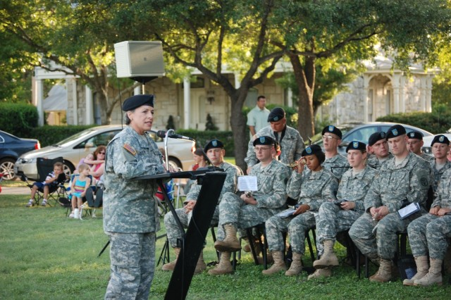 Col. Wendy Martinson, commander, U.S. Army Garrison, co-host for the summer gazebo concert, welcomes everyone to enjoy the sounds of the Army Medical Command Band. This was Martinson's last gazebo concert before her change of command July 29.