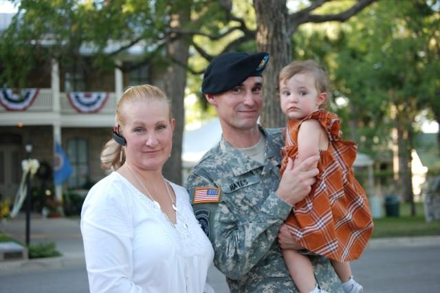 Sabina Hayes enjoys Sunday's festivities at the Gazebo with her parents, Maj. Chris Hayes, Fort Sam Houston Provost Marshal, and mom, Michaela.