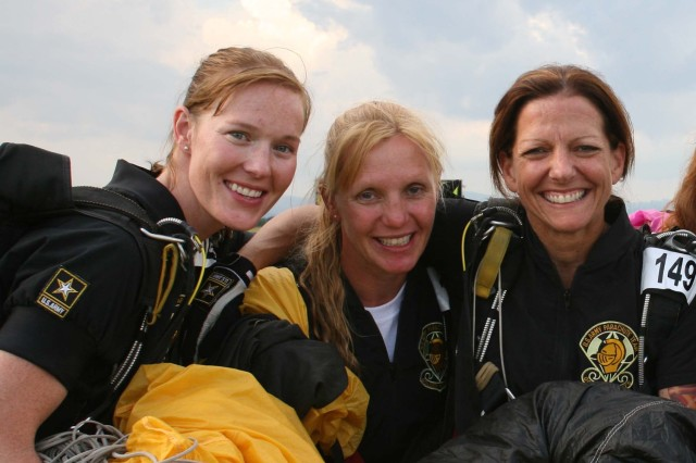 (l-r) Sergeant 1st Class Angela Nichols; Sergeant 1st Class Elisa Tennyson; and Sergeant 1st Class Karen Morrison team up following accuracy rounds during the 30th FAI World Style and Accuracy Parachuting Championships in Slovakia.