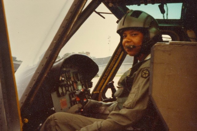 """Army Aviation pioneer and then-Capt. Christine B. """"Nickey"""" Knighton at the flight controls. In 1980 Knighton became the second black woman to complete aviation training within the Department of Defense."""