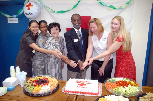 Celebrating the July 16 opening of the USAG-Red Cloud ARC building with a cake cutting ceremony are (from left) Kristina Bonic, American Red Cross; USAG-RC Command Sgt. Maj. Earlene Lavender; Mr. Kim, Jeong-Young, Korean Red Cross representative; Lawson Hughes, ARC regional manager; Deanna Young, USAG-RC ARC station manager; and Libby Worman, USAG-RC ARC assistant station manager.  http://ima.korea.army.mil/area1/sites/local/