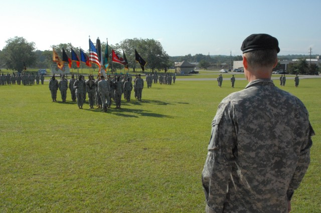 Brig. Gen. Bradley May (right), watches as the colors are formed for the Change of Command ceremony July 24 at Darby Field.