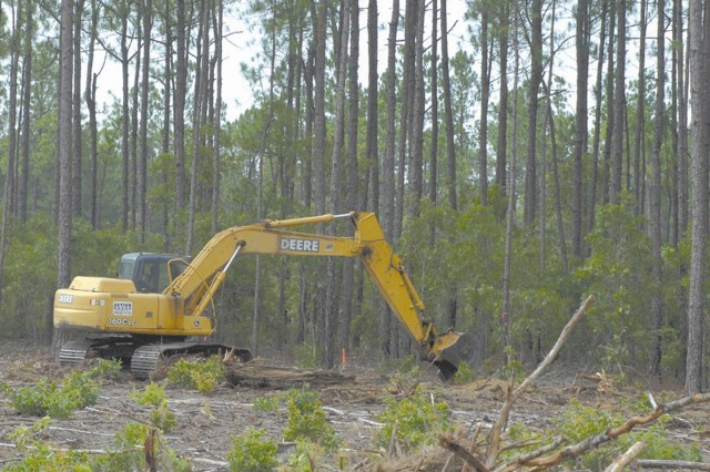 Construction crews clear land for Phase 1A of the Fort Jackson National Cemetery. Veterans Affairs officials estimate the first burials will take place in November.