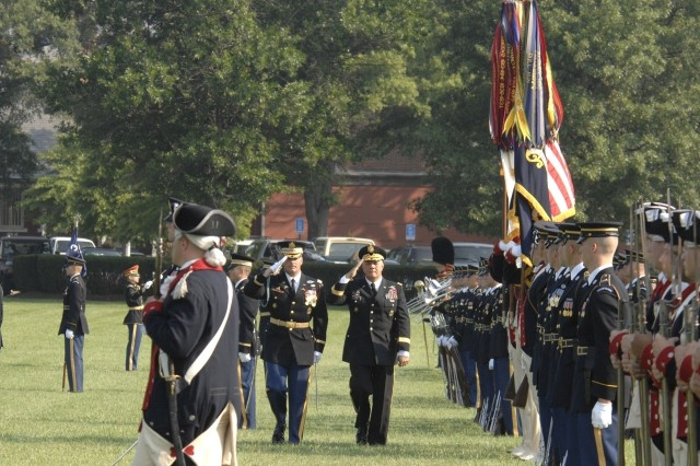 Army Vice Chief of Staff Gen. Richard Cody salutes Soldiers of the honor guard during his Aug. 1 retirement ceremony at Fort Myer, Va.