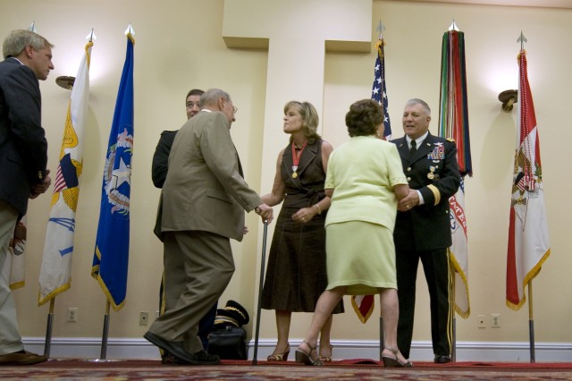 Retired Army GEN. Richard Cody and his wife, Vicki, are greeted by friends and family during a reception for Cody's retirement at Ft. Myer, VA., August 1, 2008.