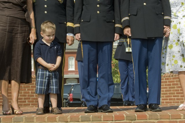 The grandson of GEN. Richard Cody, Vice Chief of Staff of the Army, stands by his family during his grandfather's retirement ceremony at Ft. Myer, VA., August 1, 2008.