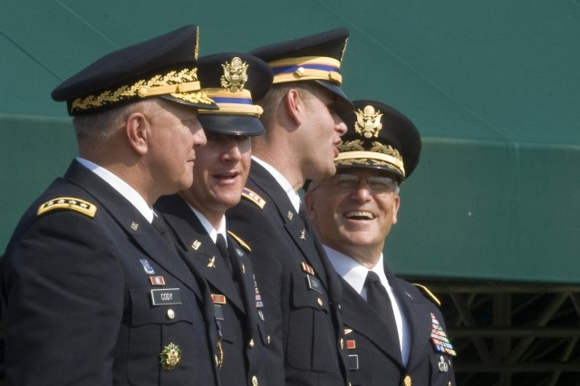 Vice Chief of Staff of the Army, GEN. Richard Cody, left, his two sons Clint and Tyler and the Chief of Staff of the Army, GEN. George W. Casey, Jr., right, participate in Cody's retirement ceremony on Ft. Myer, VA., August 1, 2008. General Cody's sons are both Captains and Army aviators.