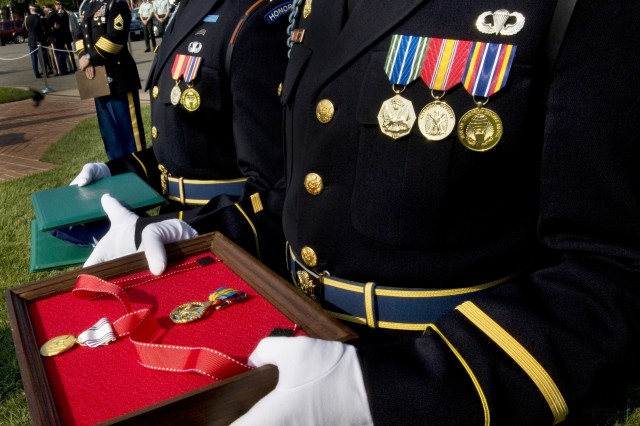 Soldiers with the Third Infantry Regiment hold the medals that will be awarded to GEN. Richard Cody, and his wife, Vicki, at Ft. Myer, VA., August 1, 2008.