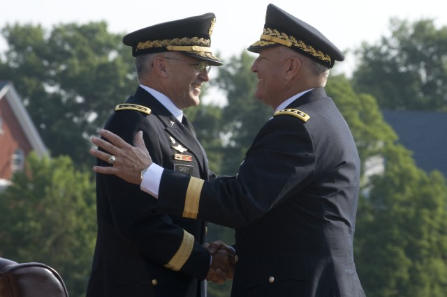 Chief of Staff of the Army, GEN. George W. Casey, Jr., and GEN. Richard Cody, Vice Chief of Staff of the Army, greet each other at the beginning of Cody's retirement ceremony on Ft. Myer, VA., August 1, 2008.