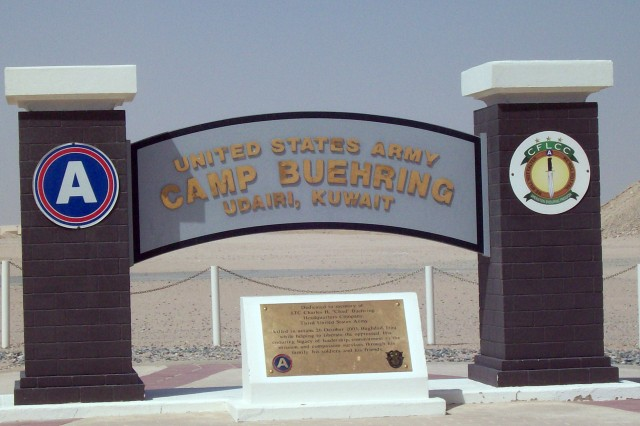 "CAPTION- Bathed in brilliant July 29, 2008, sunlight, the entrance to Camp Buehring, Kuwait includes a marker dedicated to Lt. Col. Charles H. ""Chad"" Buehring, 40, who was killed during a rocket attack in Baghdad, Iraq, Oct. 26, 2004. Described by a fellow Citadel graduate as ""a pretty normal cadet,"" Buehring was Airborne, Ranger and Special Forces qualified. The wear of all three tabs above the Shoulder Sleeve Insignia is informally known as the ""triple canopy."""