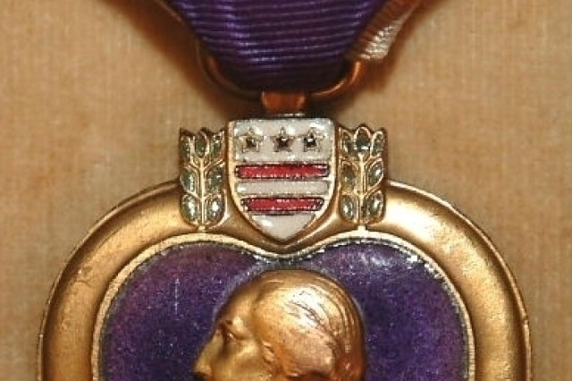 This Purple Heart was awarded to Private Elmer M. Kann on  August 5, 1932.  Kann, a bugler for Company C, 316th Infantry Regiment, 79th Infantry Division, was wounded on November 3, 1918, during the Meuse-Argonne Offensive.