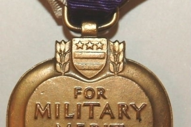 This is a reverse view showing the inscribed name on the Purple Heart awarded to Private Elmer M. Kann on  August 5, 1932.  Kann, a bugler for Company C, 316th Infantry Regiment, 79th Infantry Division, was wounded on November 3, 1918, during the Meuse-Argonne Offensive.  Photo by the U.S. Army Heritage Museum.