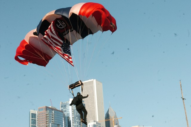 Sgt. Derrick Coleman, a U.S. Army Golden Knight, heads the 82d Airborne Division All American Freefall Team in a jump to usher in the opening ceremony of the 2008 Kup's Purple Heart Foundation Cruise at Navy Pier in Chicago, Ill. on July 31, 2008.
