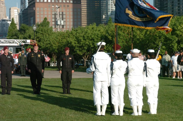 A Navy Color Guard waits to escort Soldiers from the 82d Airborne Division All American Freefall Team to their seats after their successful jump at the 2008 Kup\'s Purple Heart Foundation Cruise opening ceremony at Navy Pier in Chicago, Ill. on