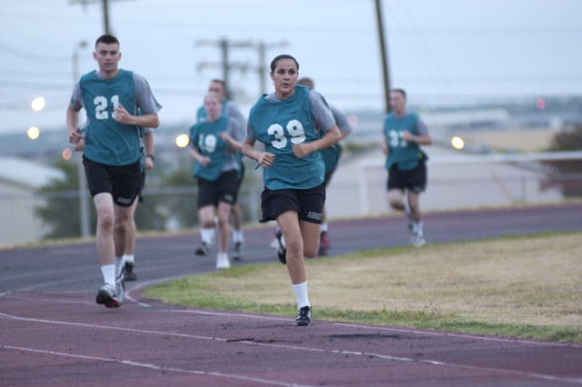 Sgt. Lisa Morales of the 40th Signal Battalion, 11th Signal Brigade, Fort Huachuca completes the 2-mile run for the Army Physical Fitness Test portion of the Forces Command Noncommissioned Officer of the Year competition at Hood Stadium on Fort Hood, Texas, July 29.