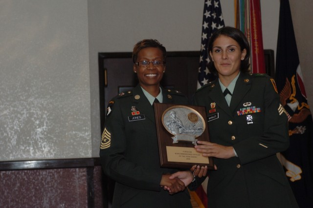 Sgt. Morales accepts an award after being named the Forces Command Noncommissioned Officer of the Year at Fort Hood, Texas.