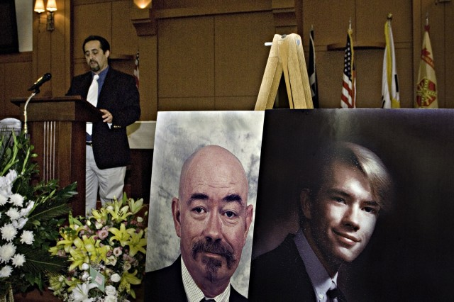 Anthony Gray speaks at the memorial service for John M. Wood. Gray was a longtime friend of Wood, who died July 23.