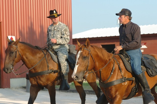 Sgt. Maj. of the Army Kenneth O. Preston rides alongside Larry Borth, a training instructor and stable master for the Horse Cavalry Detachment, 1st Cavalry Division, during an Aug. 4 visit by Preston to Fort Hood, Texas.  Also on horseback, the 1st Cav. Div. command sergeant major, Command Sgt. Maj. Rory Malloy (not pictured) and the division's brigade command sergeants major joined Preston for the ride.