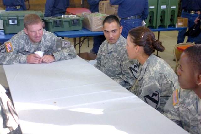During his visit to Fort Hood, Texas, Sgt. Maj. of the Army Kenneth O. Preston (left) listens intently to the concerns of Forney, Texas native Pfc. Amanda Jenkins (second from right), a combat medic for Battery A, 2nd Battalion, 82nd Field Artillery Regiment, and other Soldiers Aug. 4 while discussing issues currently facing deploying Soldiers.