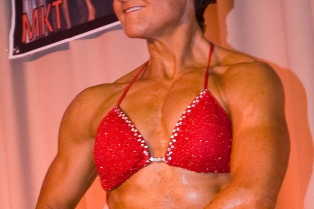 Tracey Briggs, here posing at the Oct 2007 Yongsan Bodybuilding competition, shares a Good Neighbor partnership with Seoul's Tongwon College Department of Fitness and Health Management. Briggs has guest posed and served as a judge at the college's bodybuilding contest and presented a lecture on fitness and bodybuilding.