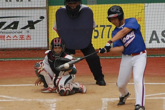 Batter Chris Horton, 13, nails a home run during Seoul Baseball Club little league play in June. The SBC, made up mainly of U.S. military children from the Seoul area, is the first foreign little league team to become a member of the Korean Little League Baseball Federation.