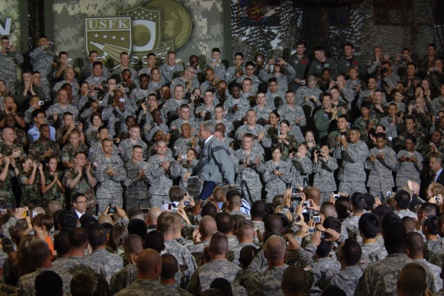 President George W. Bush takes to the stage during a Presidential Town Hall meeting Aug. 6, before addressing military personnel, Families, and Department of Defense Civilians at Yongsan Garrison, Seoul, Republic of Korea.