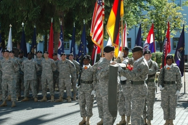 Lt. Col. David Astin (left), commander of U.S. Army Garrison Darmstadt, Germany, and Command Sgt. Maj. Harold Littlejohn case the garrison's colors during inactivation ceremonies Aug. 5.