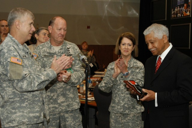 Gen. Benjamin S. Griffin, commanding general of the U.S. Army Materiel Command; Brig. Gen. William H. Forrester, director of Army Safety and commanding general of the U.S. Army Combat Readiness/Safety Center; and Col. Cherry Gaffney, AMC's command surgeon; congratulate Douglas Day of AMC's Radford Army Ammunition Plant for winning the 2007 Department of the Army Individual Award of Excellence in Safety. AMC also won the 2007 Army Headquarters Safety Award for its superior contributions to Army Combat Readiness.