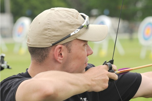 Tyler Wilson, 23, an Army veteran from Thornton, Colo., keeps his eye on the target during the archery competition at the 28th National Veterans Wheelchair Games in Omaha, Neb. Wilson earned a silver medal at that event, along with two golds in trapshooting and airguns, and a bronze in bowling.