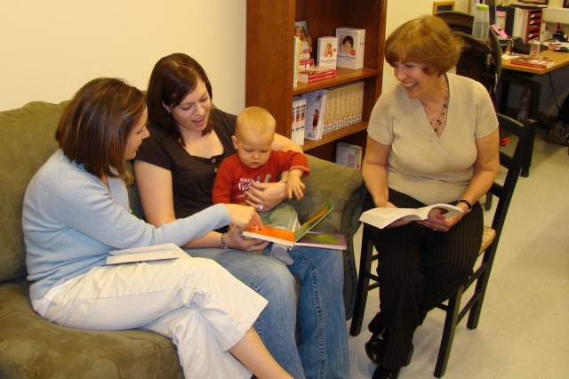 New Parent Support staff members Laura Knarr, left, a registered nurse, and Dr. Priscilla Fleischer, far right, a licensed clinical social worker, meet with Amy Bradley and son, Blayke, at the U.S. Army Garrison Hohenfels Army Community Service in Germany. Hohenfels ACS recently received accreditation with commendation, receiving a score rating it the top ACS in Europe evaluated under newly developed guidelines.