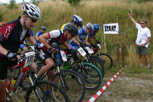 ANSBACH, Germany - Mark Juliano fires the starter pistol for a 25k men's race held at the Urlas Training area July 26 as part of the 2008 U.S. Forces Europe Mountain Bike Championship Series. Anthony Delauder took first place with a finish of one hour, 15 minutes and 47.3 seconds.