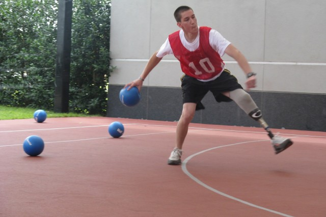 "Zachery Arnold of the ""Disco Knights"" holds his own as he winds up for a throw against an opposing team."