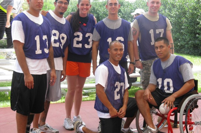 """Purple Heart Cobras"" Mike Gallardo, Eli Ramos, Heather Gardner, Andrew Looney, John Farwell, Mike Okikawa and Rico Roman are the undefeated champions of the first Warrior Transition Battalion Dodge Ball Tournament."