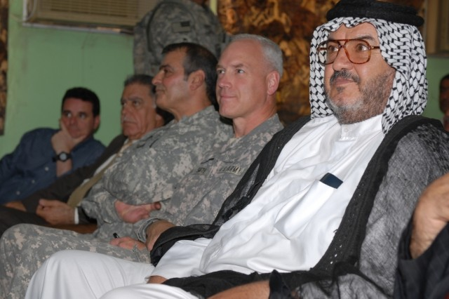 Col. Jefforey Smithm (2nd from right) , MND-Central deputy commander for support, attends a business exposition at the Iskandariyah Industrial Complex Aug. 3.
