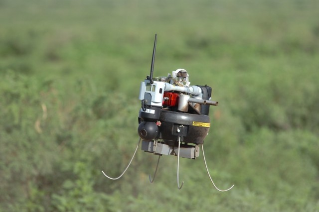 A Micro Air Vehicle takes off near a DoAfA+-a Ana, N.M., mountain range July 30 during a three-day training exercise conducted by Soldiers of the 2nd Combined Arms Battalion to test the experimental technologies of Army Future Combat Systems.