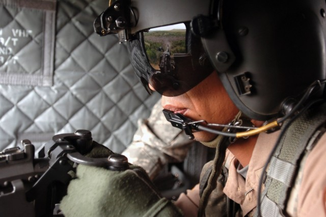 Sgt. Miguel-Angel Gonzalez, a flight engineer from Oxnard, Calif., fires his M60 machine gun from the side of a new CH-47F Chinook during an aerial gunnery exercise conducted by crewmembers of Company B, 2nd Battalion, 227th Aviation Regiment, 1st Air Cavalry Brigade, 1st Cavalry Division, at Fort Hood, Texas, July 16.