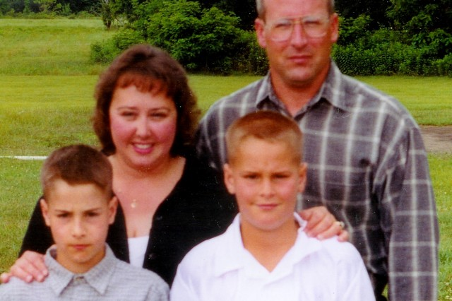 From left, Joshua, Dawn, Brandon and Kevin Cavalet pose for a picture in 2001, two years before Joshua's accident.