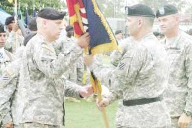 Col. Charles E.A. Sexton receives the 2nd Brigade Combat Team, 3rd Infantry Division colors from Maj. Gen. Tony Cucolo, 3rd Inf. Div. commanding general, and assumes command of the Spartan Brigade, Aug. 1 at Marne Garden. Sexton replaces Col. Terry Ferrell.