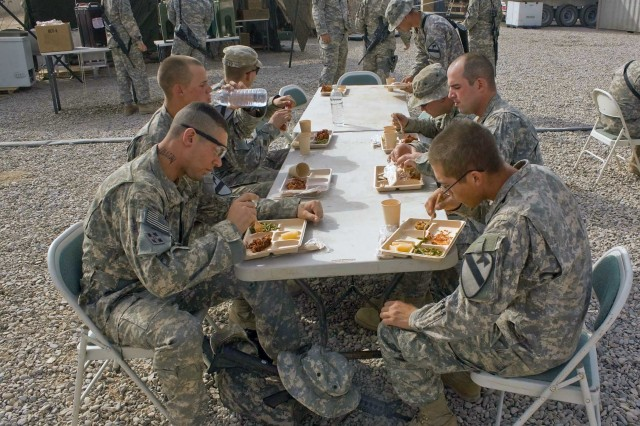 Soldiers eat breakfast outside the containerized kitchen at Forward Operating Base Garry Owen near Amarah Aug. 2.