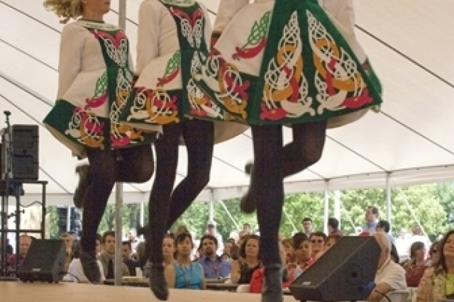 """PICATINNY ARSENAL, N.J. - Members of the Davis Academy of Irish Dance leap before the Picatinny crowd during Multicultural and Employee Day here July 10."""""""