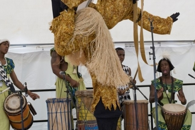 """PICATINNY ARSENAL, N.J. - The Universal African Dance and Drum Ensemble performs at the annual Multicultural and Employee Day celebration here July 10."""""""