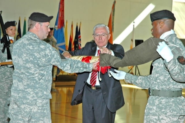 Col. Ray Graham and Dr. Robert Schloesser case the U.S. Army Garrison Hessen, Germany, colors during a closure ceremony Aug. 7.