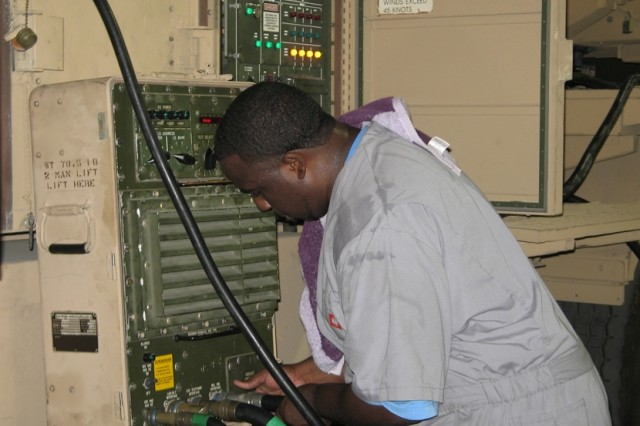 Lockheed Martin Corporation employee Larry Davis uses a Launching Station Test Set to perform maintenance on a Phased Array Tracking Radar Intercept Of Target launcher, August 6, 2008, at a 1st Battalion, 401st Army Field Support Brigade maintenance and storage facility at Camp As Sayliyah, Qatar.  The LSTS provides fault codes which enable the technician to troubleshoot and perform diagnostics on PATRIOT Missile System launchers.