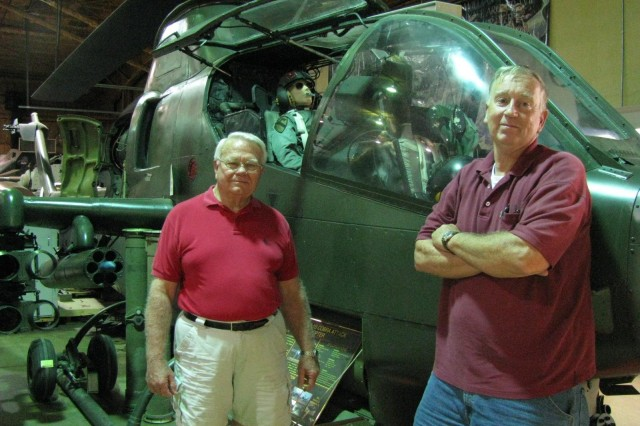 Veterans Memorial Museum volunteer Bob McCoy and museum director Randy Withrow, standing in front of a Cobra attack helicopter, are proud of the work volunteers have done to collect, display and maintain the extensive display of hardware at the museum. The city has asked the museum and its volunteers to prepare for a move to a new home when its lease runs out in 2010.